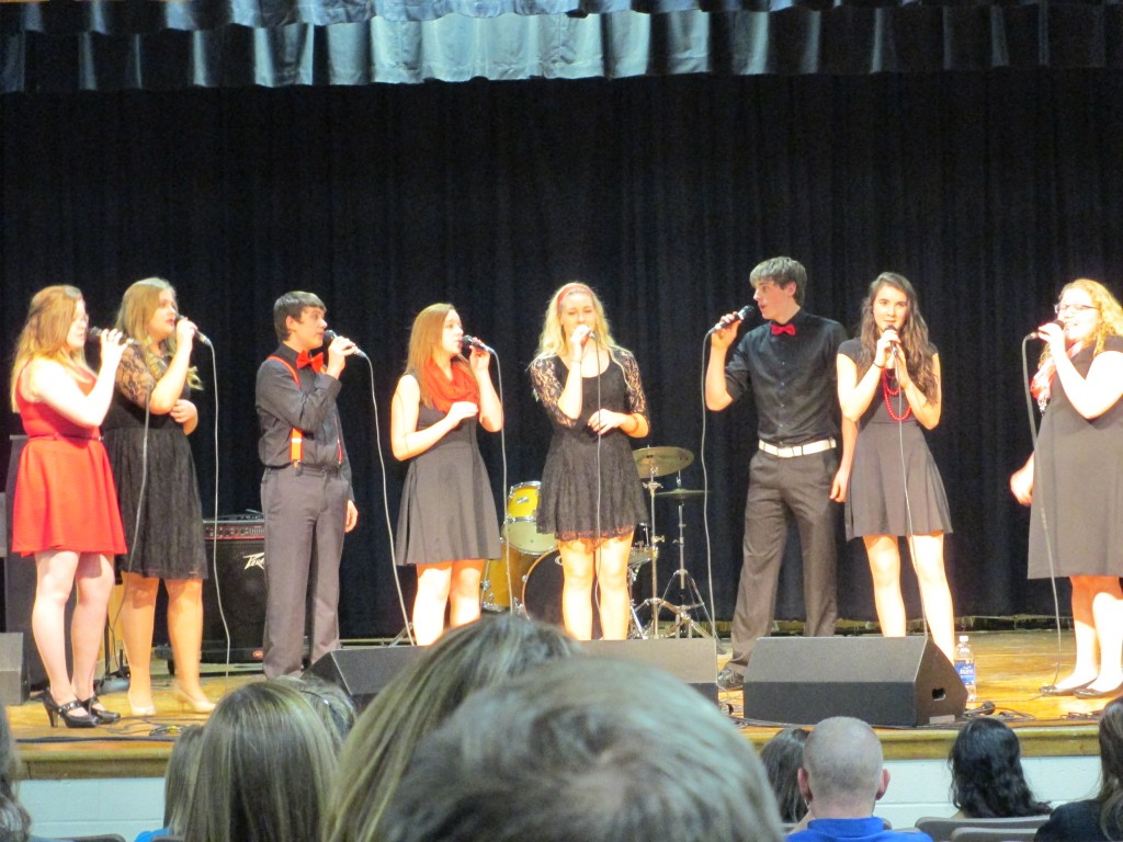 Students singing during a performance